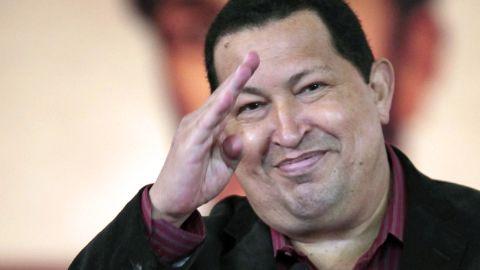 Venezuelan President Hugo Chavez gestures after signing a new labour law in Caracas on April, 30, 2012.