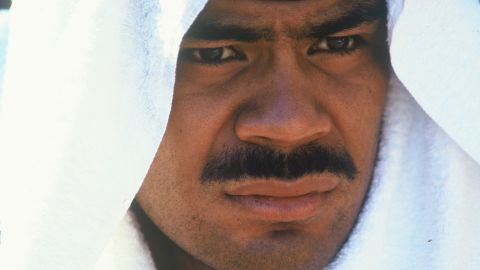 Seau sits with a towel over his head during a game at Jack Murphy Stadium in San Diego in 1996.