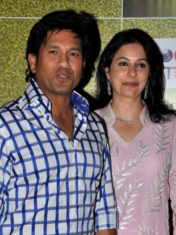 """Tendulkar, pictured with his wife Anjali, was honored at the """"Real Heroes Awards"""" ceremony in Mumbai in March, run by the Reliance Foundation and CNN affiliate broadcaster CNN-IBN."""