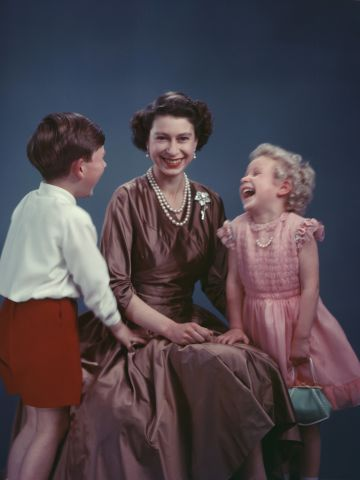 From the Royal Collection -- the queen sits for a photograph with a young Prince Charles and a very blonde Princess Anne.