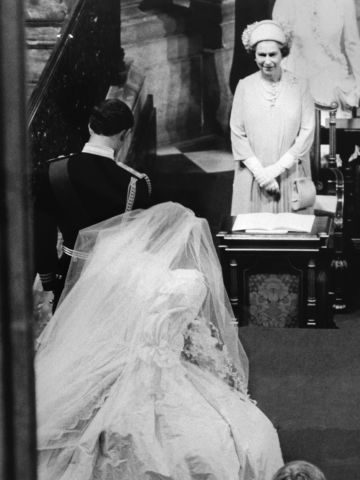The queen's eldest child, Charles, Prince of Wales, bows while his new bride, Princess Diana, curtsies to the British sovereign as they leave St Paul's Cathedral, on July 29, 1981.