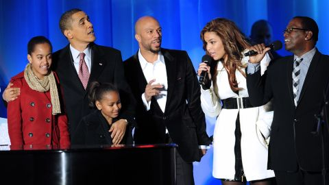 """Obama and his daughters, Malia and Sasha, sing with rapper Common, singer Jordan Sparks and """"American Idol"""" judge Randy Jackson during the National Christmas Tree Lighting ceremony on December 3, 2009."""