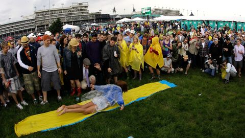 While the jetset sip Mint Juleps from air-conditioned boxes, college students on spring break pack the infield.