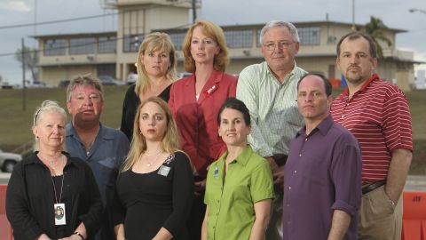 Family members of 9/11 victims attend a war court trial on the U.S. Navy Base in Guantanamo Bay, Cuba, to witness the hearing of alleged 9/11 accomplices. Bottom row, front left: Christina Russell and husband Clifford Russell, Tara Henwood-Butzbaugh, Susanne Sisolak, and Eddie Bracken. Top row: A woman who did not wish to be named, Mary Henwood-Klotz, Blake Allison, and man who did not wish to be named.