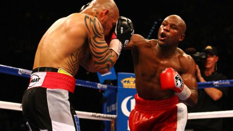 Floyd Mayweather Jr. throws a right to the face of Miguel Cotto during their WBA super welterweight title fight  Saturday