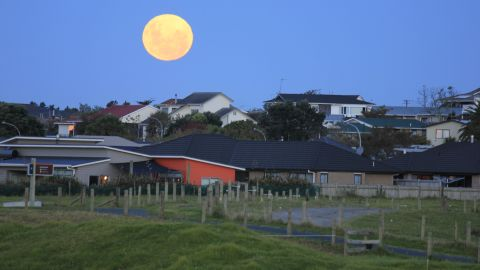 """""""I went to the farm 30 minutes before the moon rises. It brought forth excitement when the moon started to rise above the suburban skyline,"""" iReporter Jerry Phons of New Plymouth, New Zealand, said in May 2012."""