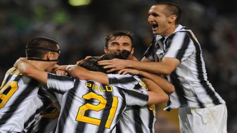 Players of Juventus FC celebrate after beating Cagliari 2-0 to win the Serie A Championships Sunday in Trieste, Italy.