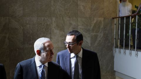 Israeli PM Benjamin Netanyahu (L) listens to Cabinet Secretary Zvi Hauzer before a weekly cabinet meeting, Jerusalem, May 7.