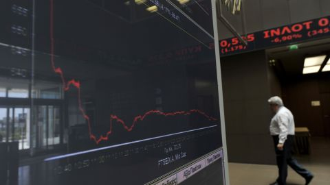 An employee walks by an index at Athens stock exchange on May 7, 2012 after voters in France and Greece voted out their ruling parties in a backlash against austerity measures aimed at battling the eurozone crisis.