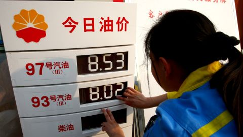A worker changes the price panel at a petrol station in China's Sichuan province last March.