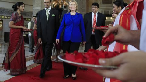 US Secretary of State Hillary Clinton (C) leaves the Taj Hotel in Kolkata on May 7, 2012.
