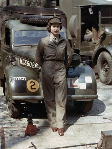 Auxiliary Territorial Service: Princess Elizabeth, a 2nd Subaltern in the ATS, wearing overalls and standing in front of an L-plated truck. In the background is a medical lorry. Courtesy Imperial War Museum