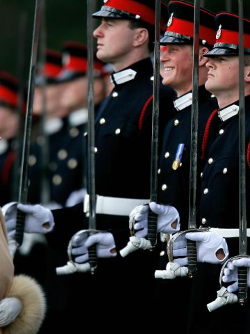 Since the death of Diana, the queen's popularity has enjoyed a revival as she continues to preside over what appears to be a softer, more accessible modern royal family. Here, she attends her grandson Prince Harry's graduation from the Royal Military Academy at Sandhurst, southern England in 2006.