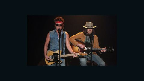 """Bruce Springsteen and Jimmy Fallon, as Neil Young, perform on the March 2, 2012 episode of """"Late Night with Jimmy Fallon."""""""
