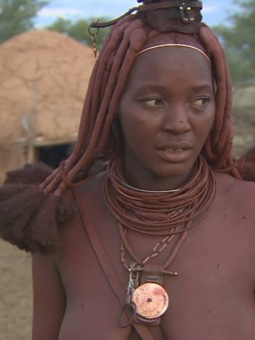 <em>Otjize</em> sometimes contains aromatic resin from a local shrub to provide an appealing fragrance. It is applied by Himba women every morning, but never by men.
