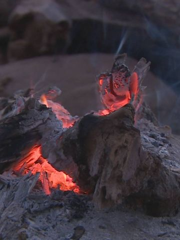 """The holy fire, or """"okuruwo,"""" is the most important feature of Himba religious life. It provides a connection to their god and ancestors, and is never allowed to be extinguished, with an ember brought into the chief's home every night."""