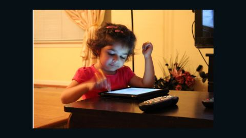 """Sharia Siddiqui uses an iPad to help her communicate. Her father says it's """"given her a sense of control she never had."""""""