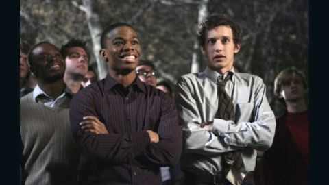 """Calvin Owens, left, played by Paul James, originally struggled to come out to his Omega Chi fraternity brothers on """"Greek,"""" which aired on ABC Family from 2007 to 2011."""