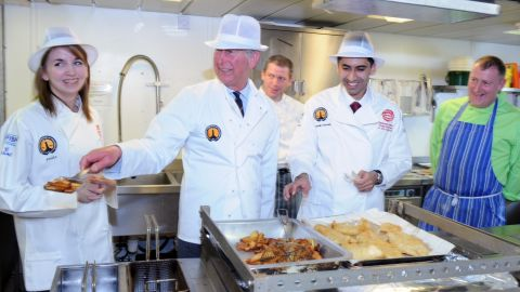 On board research vessel the Scotia, Prince Charles fried Scottish haddock with 2012 Young Fish Frier of the Year runner-up Carlyn Johnson and winner Zohaib Hussain.