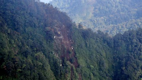 Debris of plane crash from a Russian Sukhoi Superjet 100 is seen on the slope of Salak Mountain Western Java province.