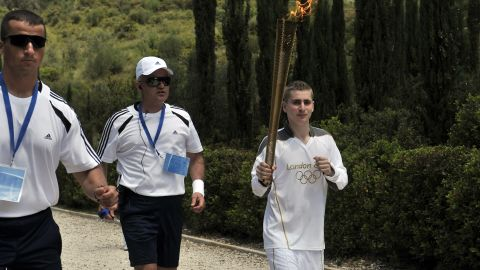 Loukos grew up in east London, where the Olympic Stadium is situated, but his father hails from Greece. Making its way to Britain, the flame will first take in Greek archaeological sites including the Acropolis and Olympic Stadium in Athens, site of the first modern Games in 1896.