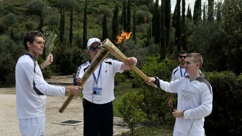 The Liverpool-born swimmer handed the torch to 19-year-old British boxer Alexander Loukos.