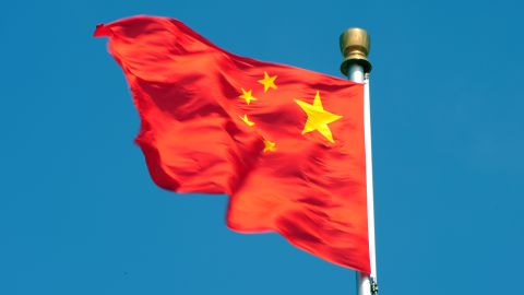 The Chinese flag flutters in Beijing's Tiananmen Square on April 11.