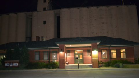 The train station in Garden City Kansas where Amtrak's Southwest Chief arrives twice a day, stands before a bank of grain elevators.