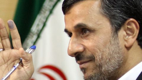 Iranian President Mahmoud Ahmadinejad waves after casting his ballot for the parliamentary election run-off at a polling station in Tehran on May 4, 2012. The vote is seen as unlikely to change the political direction of the predominantly conservative chamber, though it could help lay the ground for 2013 presidential elections. AFP PHOTO/ATTA KENARE (Photo credit should read ATTA KENARE/AFP/GettyImages)