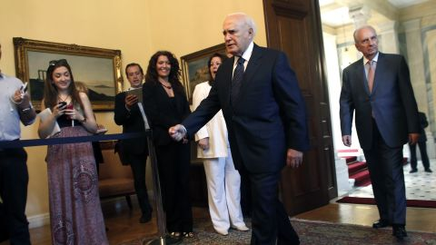 Greek President Karolos Papoulias arrives Sunday for a meeting with the leaders of Greece's top three political parties.
