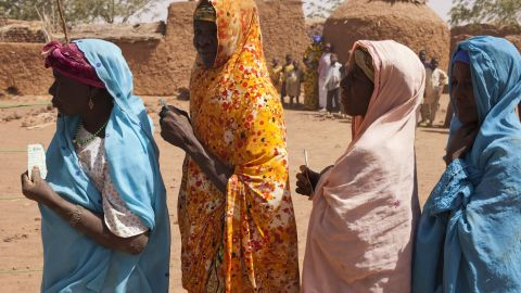 Women line up in March as part of a cash-for-work project run by CARE in Niger, which is suffering from drought.