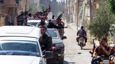 Members of the Free Syrian Army return to Qusayr after an attack near the Lebanese border on Saturday.