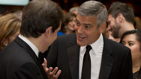 George Clooney, right, talks with Chris Wallace on April 28. Clooney's fundraiser for Obama raised $15 million in one night.