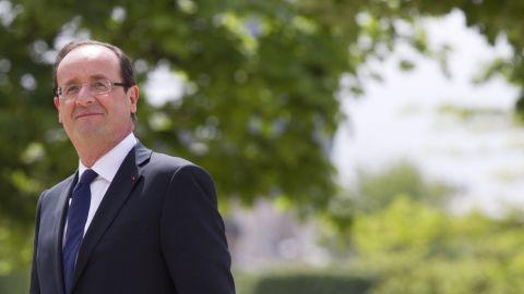 France's President Francois Hollande pauses between ceremonies May 15, 2012.