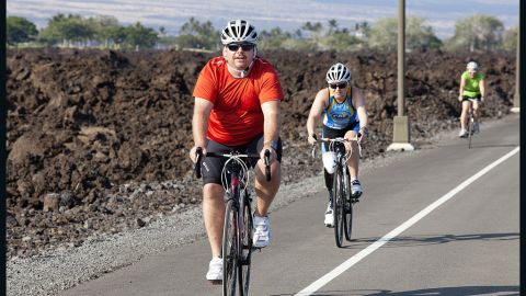 Jeff Dauler, an Atlanta radio personality, and other bikers take a training ride through the lava fields.