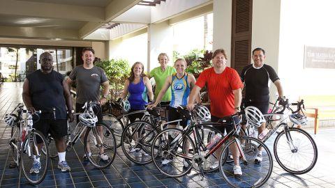 "The ""Lucky 7"" strike a pose after a training ride. From left: Glenn Keller, Rick Morris, Adrienne LaGier, Nancy Klinger, Denise Castelli, Jeff Dauler and Carlos Solis."