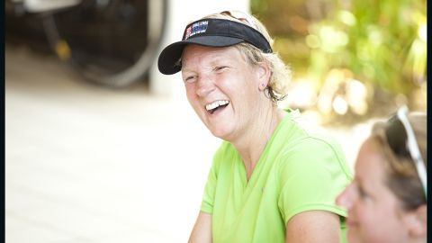 Klinger, a mother from Afton, Minnesota, shares a laugh with her teammates during a stretch.