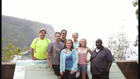 """The Fit Nation """"Lucky 7"""" arrives in Kailua-Kona, Hawaii, on Sunday, May 13, for a week of training. The group will be participating in the Nautica Malibu Triathlon with CNN's Dr. Sanjay Gupta in September. Here they take a group picture before hiking down the Waipio Valley Trail."""