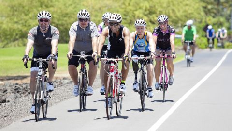 """The Fit Nation participants head off for a bike ride along the """"Queen K"""" highway in Hawaii."""