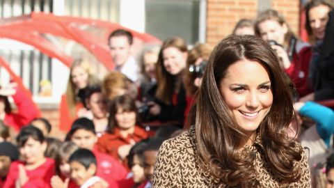 """Kate wore a printed Orla Kiely coatdress while visiting Rose Hill Primary School in Oxford. That day,<a href=""""http://www.luckymag.com/blogs/luckyrightnow/2012/02/Kate-Middletons-Printed-Orla-Kiely-Coat-Four-Similar-Options-You-Can-Buy-Right-Now#slide=1"""" target=""""_blank"""" target=""""_blank""""> Lucky magazine</a> reported that the jacket had already sold out in stores and online."""