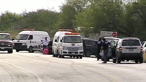 Mexican police work the grisly scene where 49 dismembered bodies were found Sunday near Monterrey.