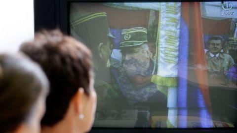 Bosnian Muslim women who survived the Srebrenica massacre, Sabra Kolenovic, right, and Sabaheta Fejzic watch the news of Mladic's arrest in Sarajevo on May 26, 2011.