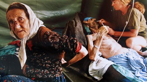 A Muslim woman and her husband are treated in July 1995 for injuries inflicted on them by Serb forces as they fled Srebrenica. The man died shortly after the picture was taken.