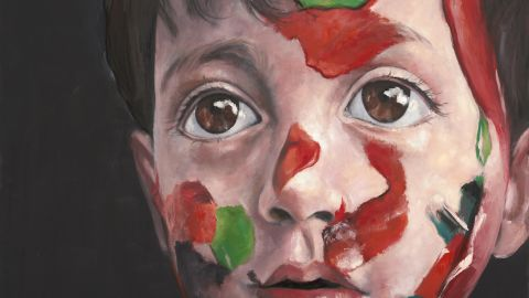 """Abdalla Omari's oil paintings, such as """"Syrian Child,"""" showing a boy with the colors of the Syrian flag painted on his face, tackle complex psychological states fraught with emotion."""
