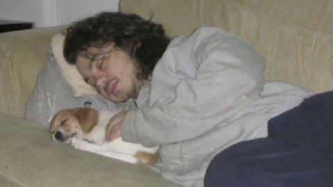 Craig Dershowitz naps with puppy Knuckles in an old family photo. He's fighting to get the dog back from his ex.
