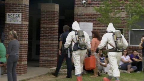 Investigators in protective gear check out a white-powder scare in Dallas last week.