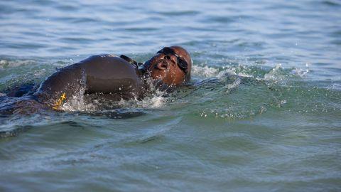Keller does an open-water swim at Hapuna Beach.