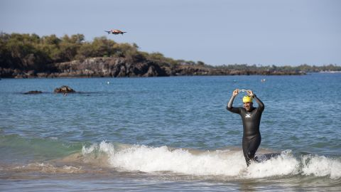 Gupta emerges from the Pacific Ocean after a training swim.