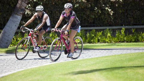 Gupta and Burkey enjoy an additional bike ride at the Mauna Lani Bay Resort in Hawaii.