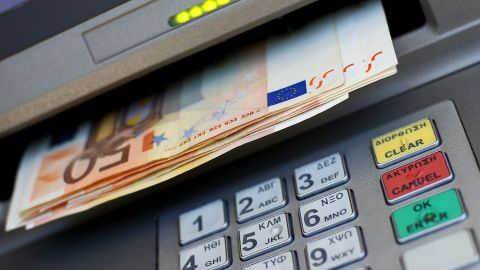 Euro notes are pictured coming out of an ATM machine on June 22, 2011 in Athens, Greece.